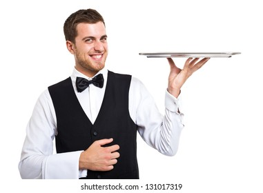 Smiling waiter holding an empty metal plate
