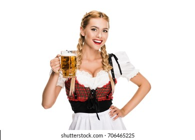 smiling waitress in traditional german costume holding beer glass on Oktoberfest, isolated on white