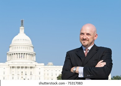 Smiling white man looking at the camera.  He's a lobbyist standing outside the U.S. Capitol in Washington DC, United States.