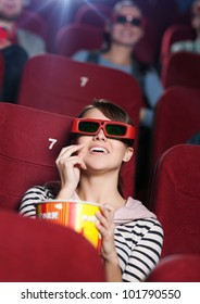 Smiling woman at the 3D cinema