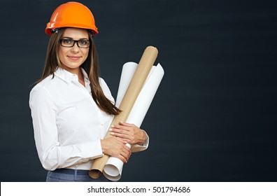 Smiling woman architect holding paper blueprint. Black background.