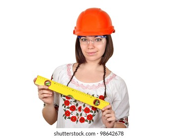 Smiling woman architect in Ukrainian blouse with gauge