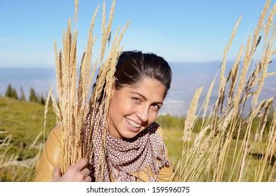 smiling woman in the autumn mountain