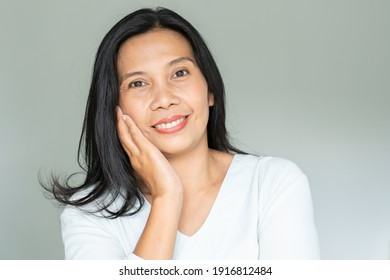 Smiling Woman with Black Long Hair. Middle Age Lady Positive Thinking in Her Life Style.