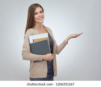 Smiling woman with book holding empty hand. Isolated portrait on white.