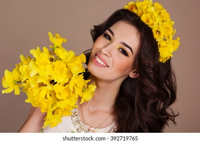 Smiling woman with bouquet of yellow flowers