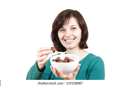 Smiling woman with bowl of chestnuts against a white background