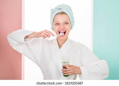 Smiling woman brushing teeth in bathroom. Teeth Care. Hygiene. Dental higiene. Oral care. Ceaning teeth. Morning routine. toothpaste and toothbrush. Shower.