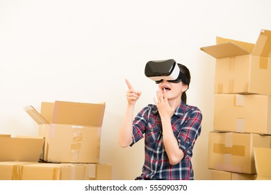 Smiling woman buying new furniture for their home with VR headset device. mixed race asian chinese model