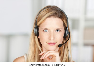 smiling woman in call center wearing headset