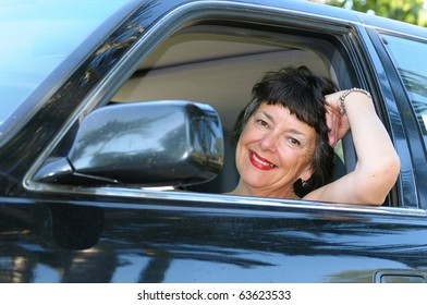 Smiling woman in a car