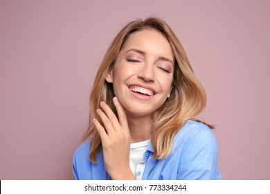 Smiling woman in casual clothes on color background