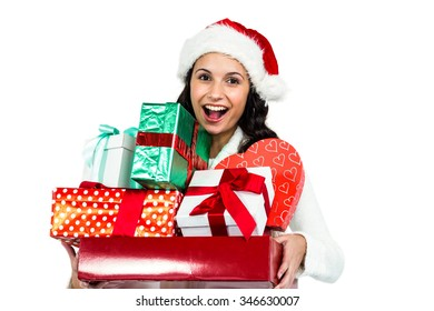 Smiling woman with christmas hat holding gifts on white screen