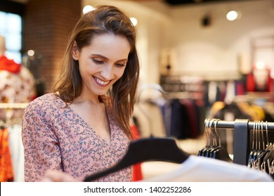 Smiling woman in the clothes shop