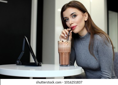 Smiling Woman with Coffee Frappe Drink at the Restaurant - Portrait of a beautiful girl with frappuccino