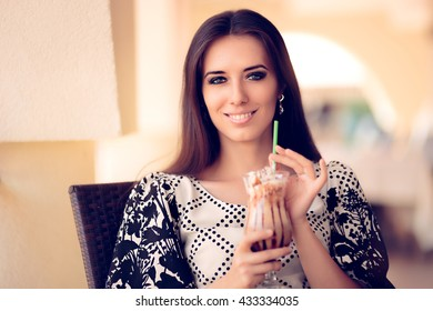 Smiling  Woman with Coffee Frappe Drink at the Restaurant - Portrait of a beautiful girl with frappuccino outside in summertime