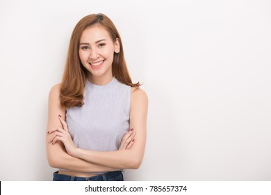 Smiling woman with crossed arms. Portrait isolated on white background.
