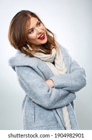 Smiling woman with crossed arms in warm winter clothes. Isolated woman portrait in winter coat