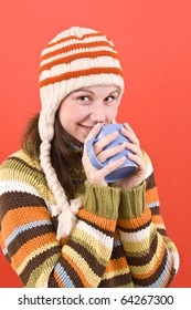 smiling woman with cup of hot-something