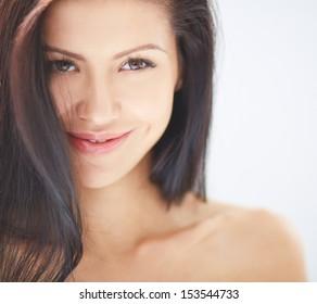 Smiling woman with dark hair looking at camera