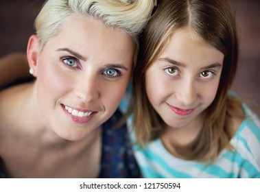 Smiling woman with daughter