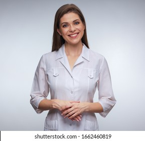 Smiling woman doctor in white uniform isolated portrait.