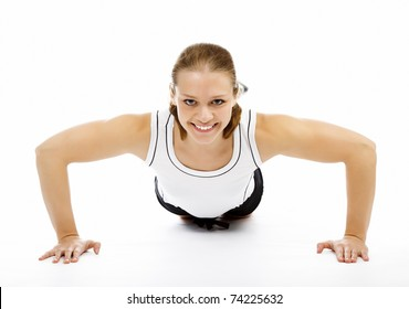 Smiling woman doing pushups on white floor