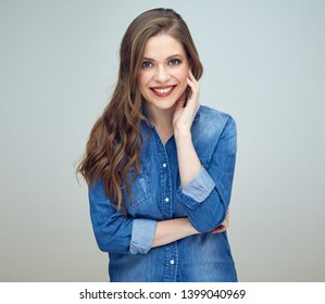 smiling woman dressed in blue denim shirt. isolated studio portrait.