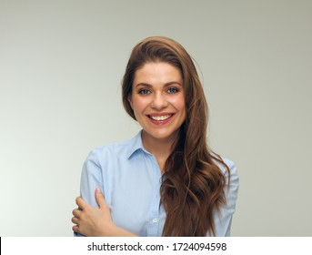 Smiling woman dressed blue shirt isolated studio portrait.
