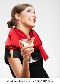 Smiling woman drinking alcohol cocktail looking up. Isolated portrait of celebrating girl.