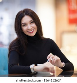 Smiling woman drinking coffee in cafe. Portrait of beautiful happy stylish woman. Fashion lifestyle. Woman style, trendy outfit.