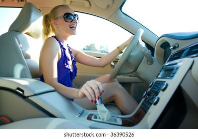 smiling woman driving car