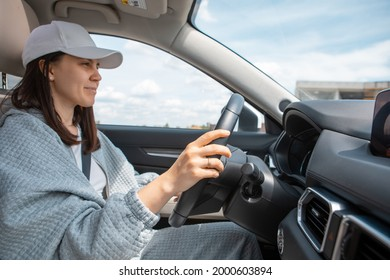 smiling woman driving car view from inside copy space