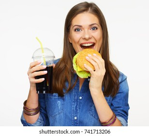 Smiling woman eating burger. White back isolated.
