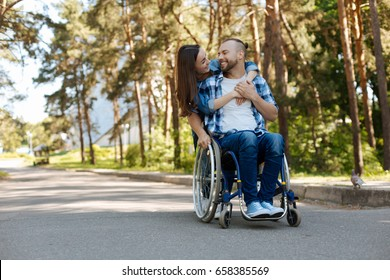 Smiling woman embracing her boyfriend