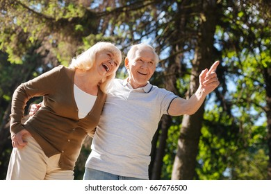 Smiling woman expressing positivity while standing near her husband