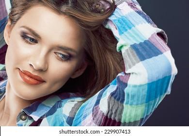 Smiling woman face close up portrait. Young model.