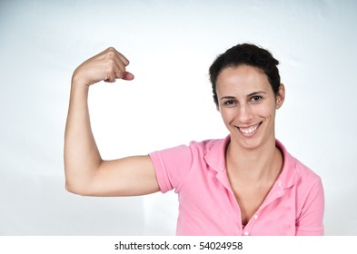 smiling woman, flexing her bicep muscle