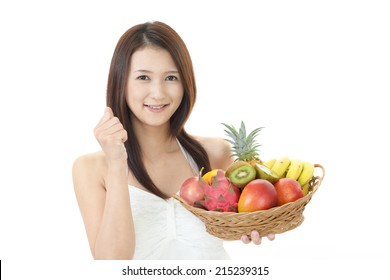 Smiling woman with fruits.