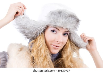 Smiling woman in fur gray hat over white