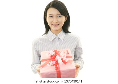 Smiling woman with a gift.