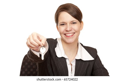 Smiling woman gives over house key. Isolated on white background.