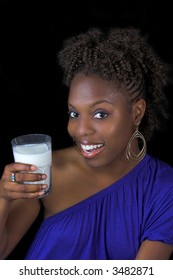 smiling woman with  glass of milk