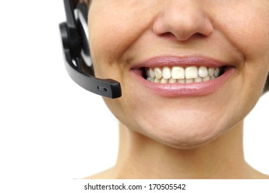 Smiling woman with headphones isolated in call center