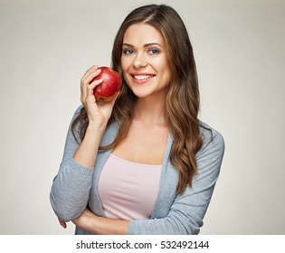 smiling woman with healthy teeth holding red apple. studio isolated portrait.