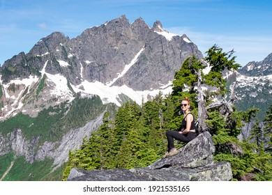 A Smiling Woman Hiker In the Cascade Mountains. 				Squire Creek, Darrington, Washington.