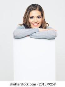 smiling woman hold white banner. isolated portrait. studio background.