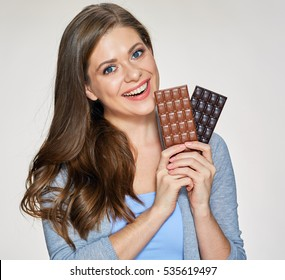Smiling woman holding black and milk chocolate. Isolated portrait .