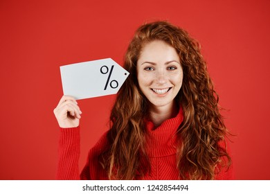 Smiling woman holding blank price tag
