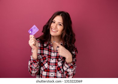 Smiling woman holding credit card. isolated portrait.